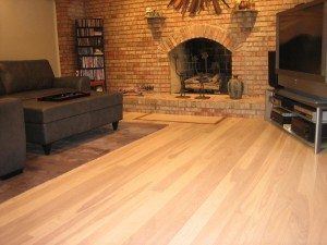 Ash Floor In Living Room with fireplace
