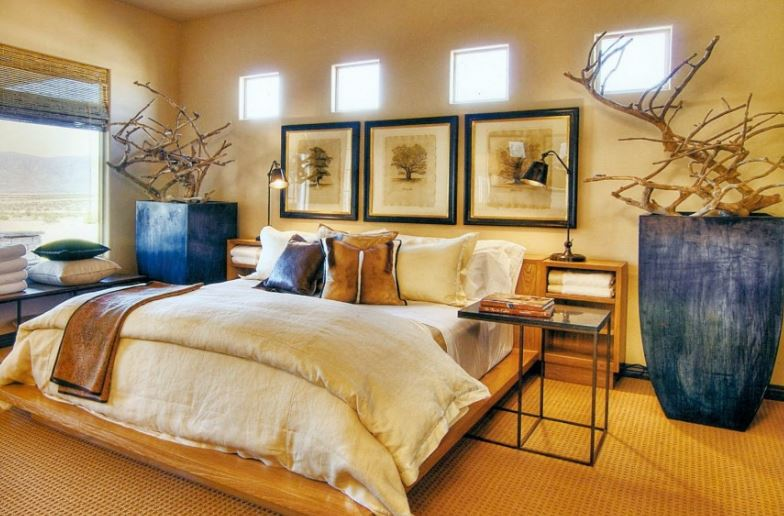 African Themed Bedroom With Wide Plank Floors