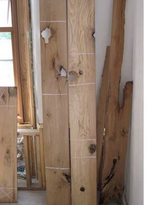 An example of reclaimed wood with giant holes, mortis, tenon holes and other issues.