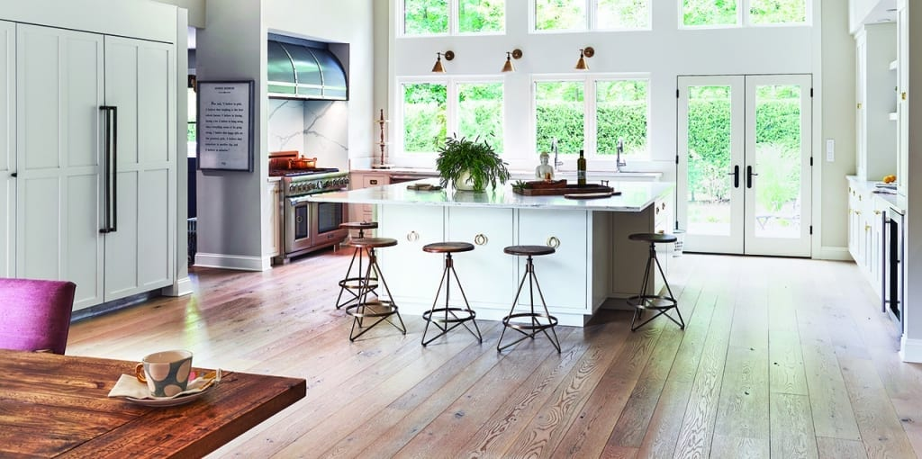 Kitchen with White Island and Brown Floors