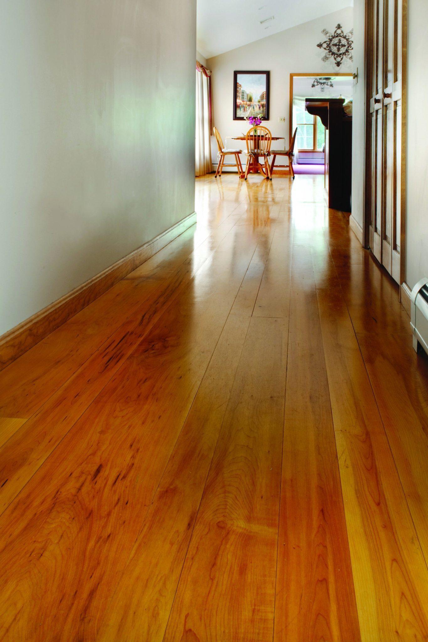 Brown Maple Hardwood Flooring In Hallway