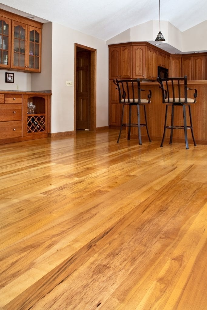 Brown Maple Hardwood Floors In A Dining Room