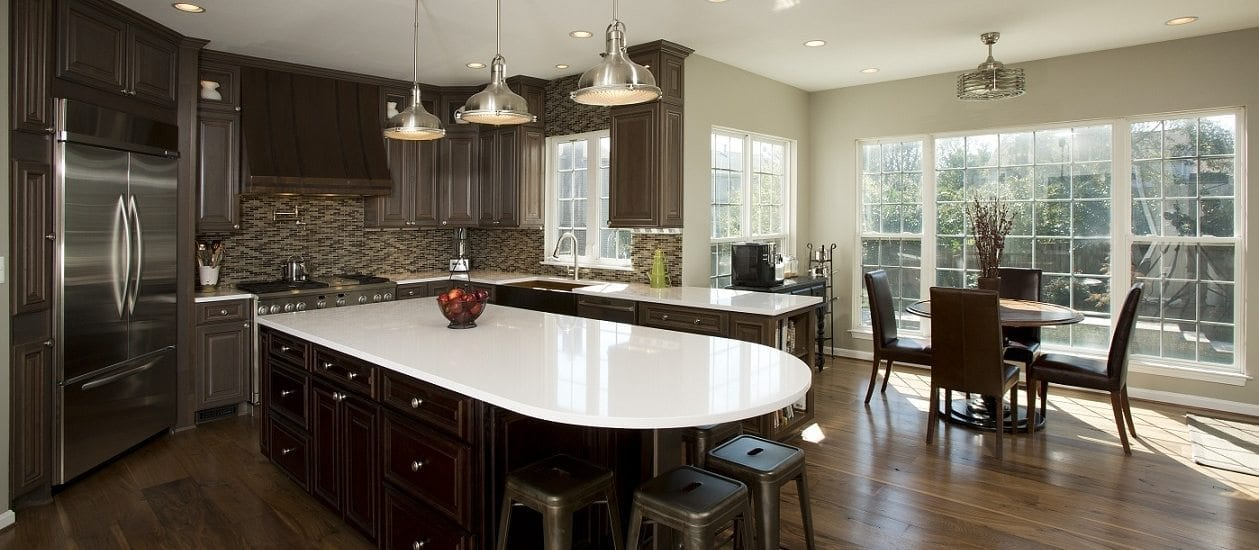 dark stained hardwood flooring and cabinets