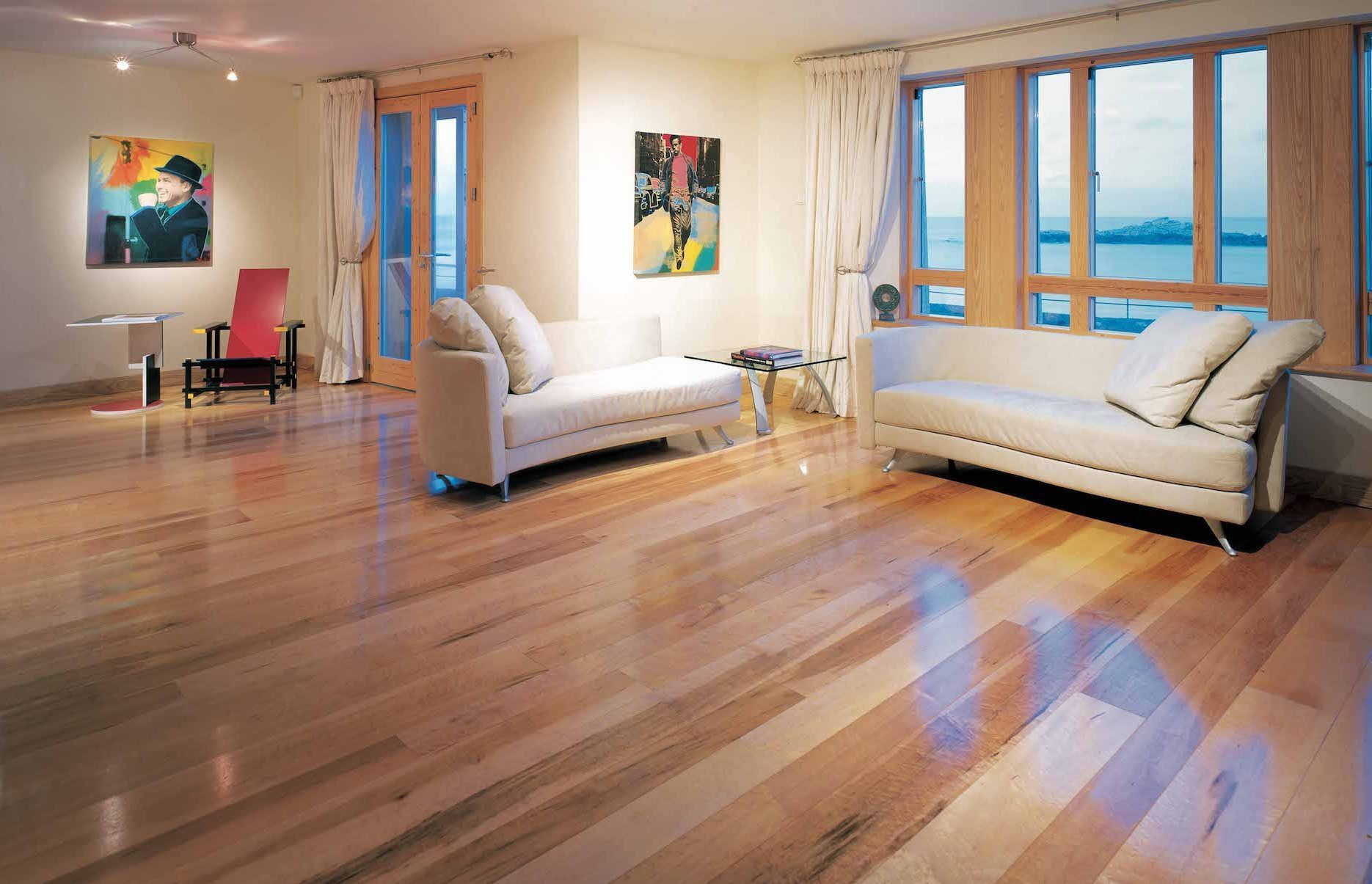 Brown Maple Wood Flooring In A Waterfront Home