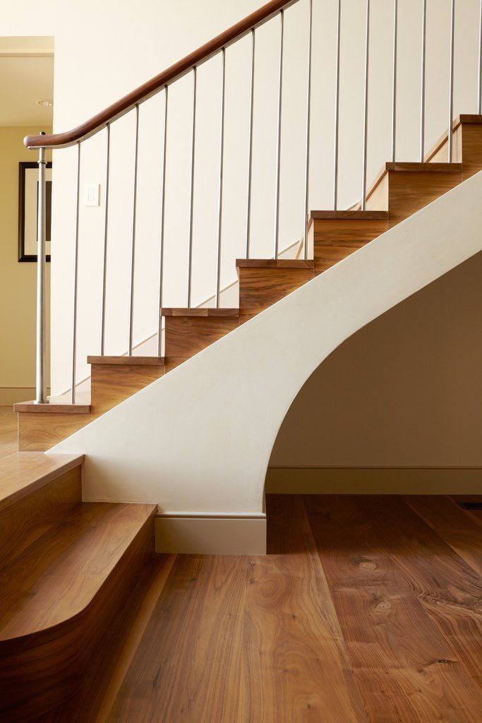 Solid wood Walnut flooring in stairwell.