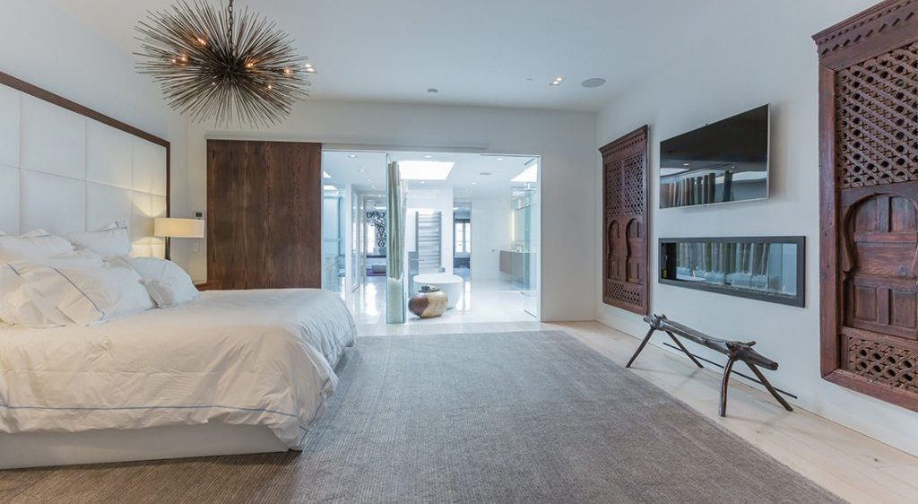 Master Bedroom with light colored floors and dark wood accents