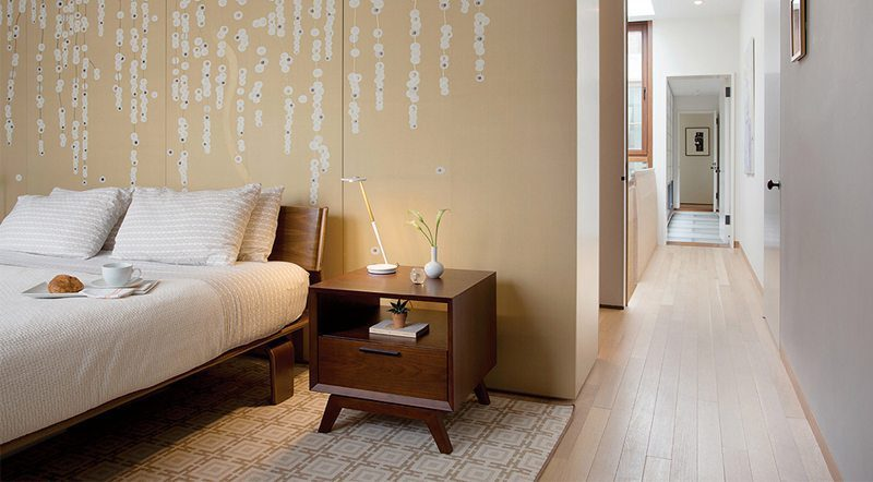 light colored wood floors with wallpaper accent