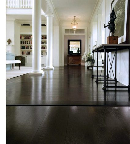 dark hardwood floors with white walls accents