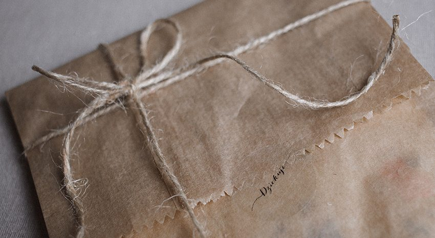 Brown paper package wrapped in string
