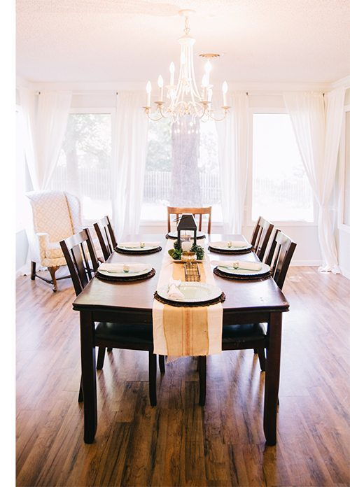 a long wooden table, ready for a holiday feast