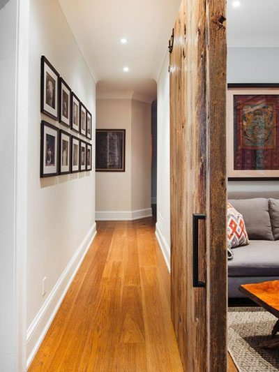 warn wood flooring in gallery style hallway