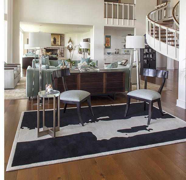 open living space with black and white wool rug