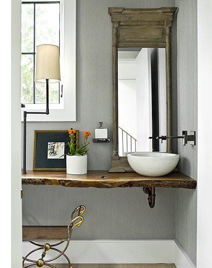 A farmhouse bathroom with natural edge counter
