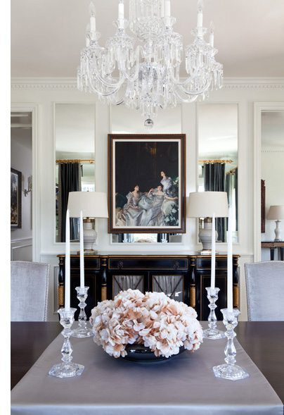 a modern dining room with crystal and floral accents