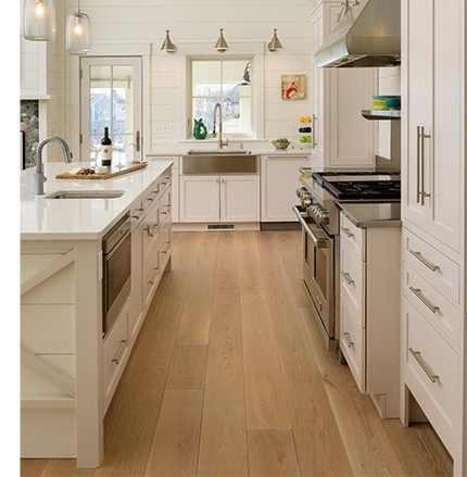open kitchen concept with wide plank flooring