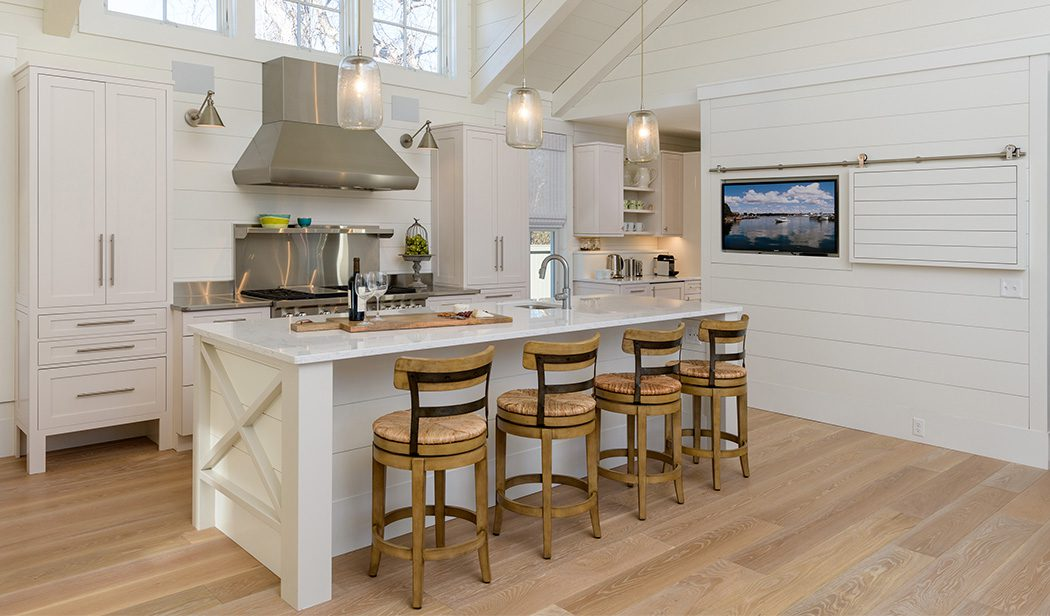 Modern farmhouse kitchen featuring White Oak hardwood flooring from Carlisle