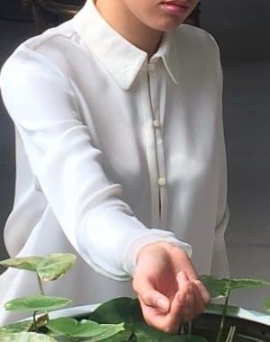 woman wearing Rhonda Cole White Shirt