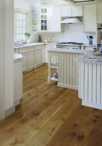 White Kitchen with brown wood floors