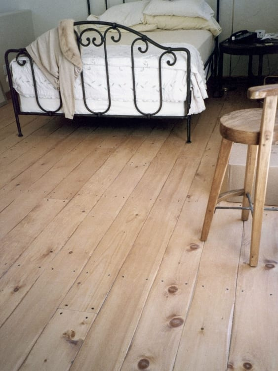 hand scraped edge flooring in bedroom